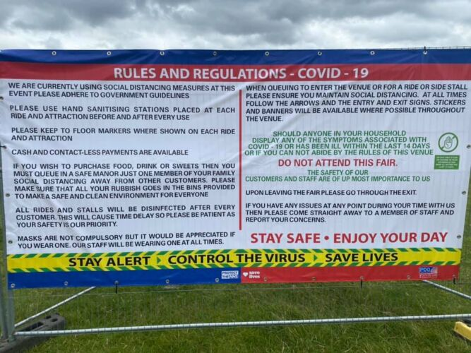 Photograph of a vinyl banner displaying the Rules and Regulations in place for our Covid Secure Fun Fair