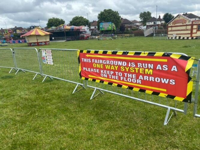 Photograph of a vinyl banner infroming the public of the one way system and to follow the floor markings as part of our Covid Secure measures.