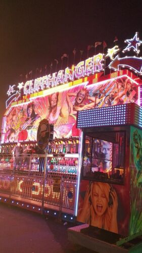 Miami ride pictured at nightime, illuminated by thousands of lights.