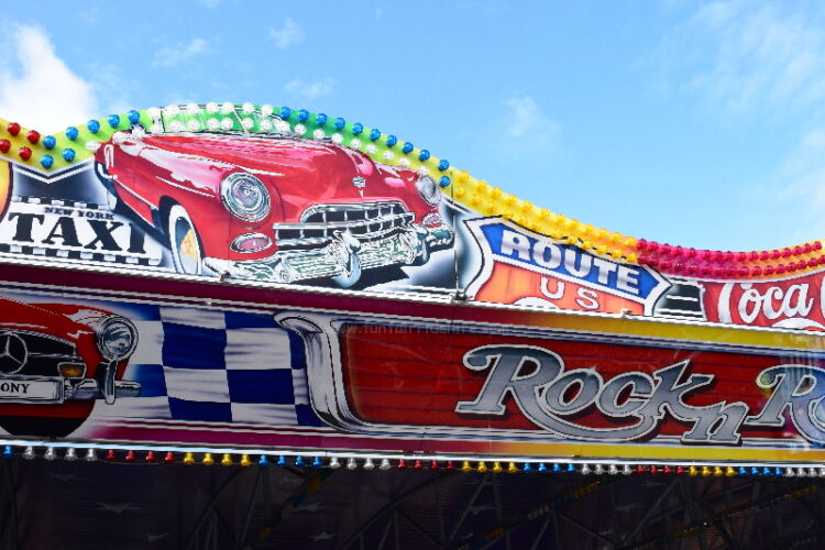 Photograph of of the artwork on our Rock'n' Roll Dodgems, featuring a red american car