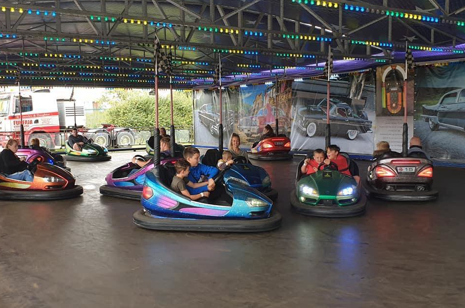 Click on this image of the people enjoying a ride on the dodgems to find out more information on Dodgem Car hire