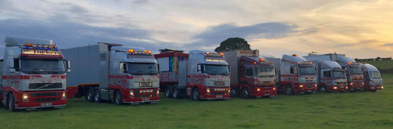 Image of G.R.Tucker & Sons fleet of lorries that are used to transport the funfair rides and attractions
