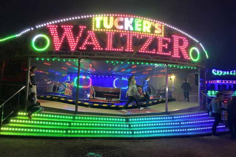 Photograph of G.R.Tuckers Waltzer at nighttime with multicoloured led lighting